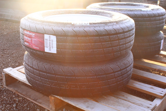 QTY 2) TRAILER TIRES ON 5 LUG WHEELS ST205 / 75-15, TAG #8496