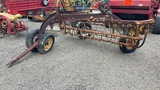 NEW HOLLAND PULL TYPE HAY RAKE WITH DOLLY WHEEL