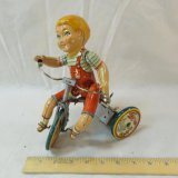 1930's tin wind up Kiddy Cyclist by Unique Art