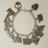 Marked Sterling travel charm bracelet 28.6gtw