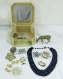 Vintage costume jewelry in jewelry box