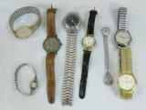 4 men's and three women's watches