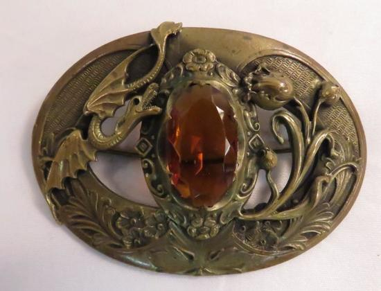 Antique art nouveau dragon brooch with amber glass
