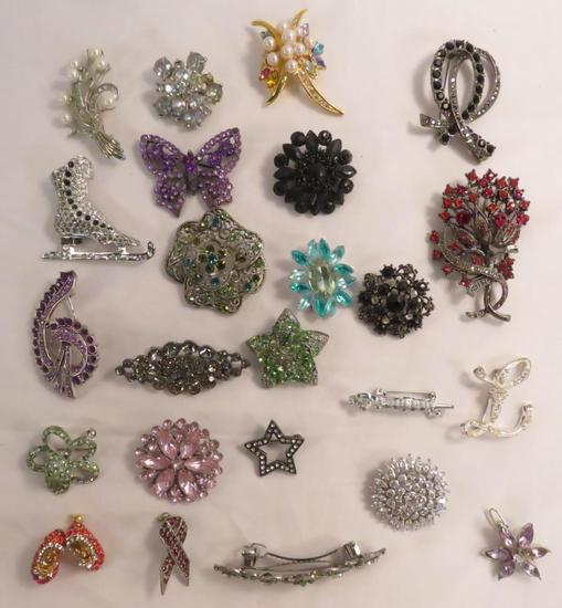 22 brooches and 2 barrettes with colored stones