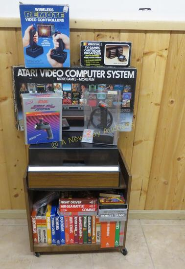 Atari console, controllers, 40 games with boxes