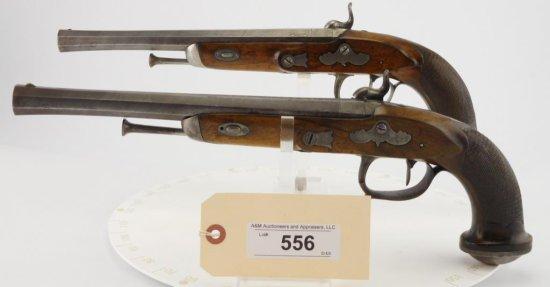 Lot #556 -Pair Canon & ForonPercussion Pistols