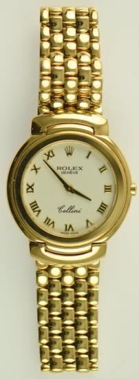 Lot #10 - 18K Yellow Gold Men's Rolex Cellini wrist watch with Roman dial & Panther link bracelet.