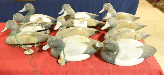Lot #323 - (11) Wingsetter Bluebill decoys al l rigged with line and weights (5) Drakes and (6)