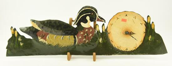 "Lot # 4574 - Hand made tin duck cut out clock with painted wood duck signed R. Donnoly (25""x 8"")"