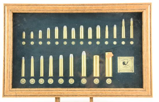 Lot # 4578 - Tatonka Cartridge Co. Waco, TX framed brass casing collage from 32 colt to 10 gauge