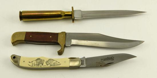 Lot # 4584 -(3) knives: 50 cal bullet handle , brass and wooden handle, Schrade Scrimshaw folder