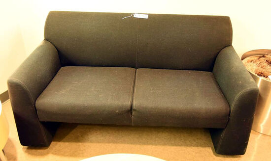 "Lot #1252 - Mueller Furniture Corporation black upholstered loveseat (30"" x 57"" x 31"") and"