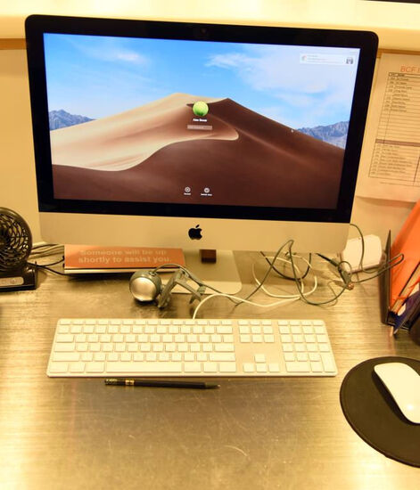 "Lot #1256 - Apple Imac model EMC 2544 21.5"" screen with Intel Core i5 in silver finish with mouse"