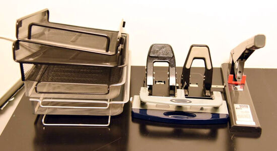 Lot #1265 - Stanley Bostitch model 00540 commercial stapler, hole punches, several file holders