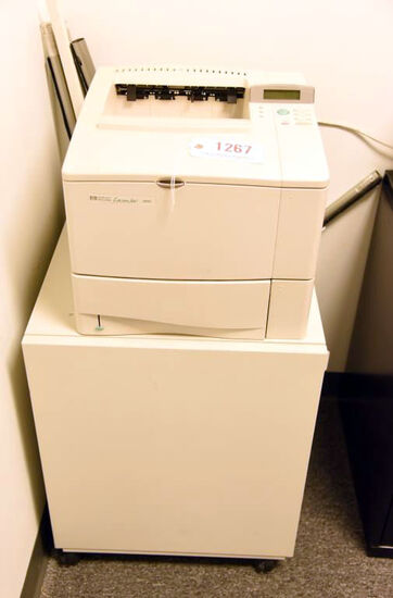 Lot #1267 - Hewlett Packard Laserjet 4000 printer with printer stand/cabinet and spare premium