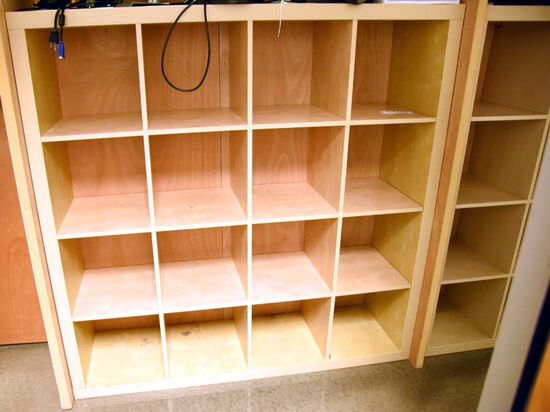 "Lot #1270 - Contemporary natural finish 16 compartment storage case/bookcase (59"" x 59"" x 17"")"