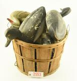 Bushell basket of vintage decoys to include: Pair of Mallards, (2) Bluebills and motorized decoy