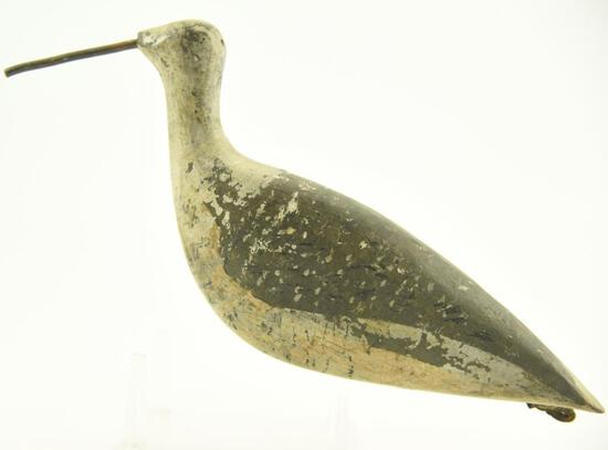 Lot #329 - New England Mass. Plover decoy with leather rigging/carry strap on rear, cast iron