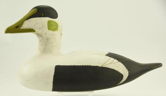 Lot #336 - New England Carved Eider drake decoy in original paint with glass eyes unsigned