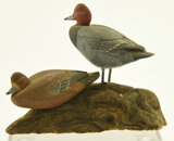 Lot #452 -Pair of miniature carved standing full body Redheads on driftwood base signed A.J.
