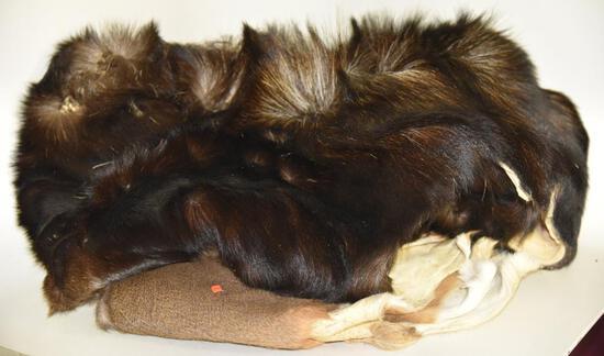 Lot #2 -Black bear hide and white tail deer hide (deer hide as a hole in it)