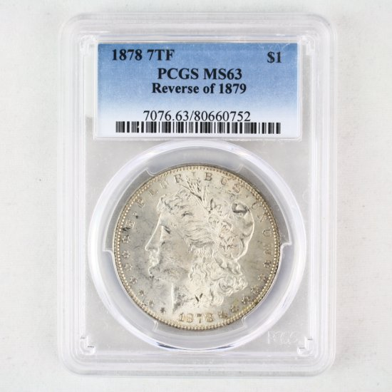 Certified 1878 7 tail feathers, reverse of 1879 U.S. Morgan silver dollar