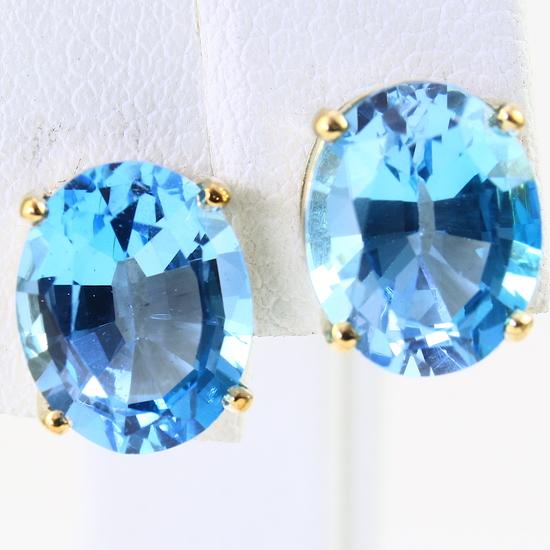 Pair of estate 14K yellow gold blue topaz stud earrings