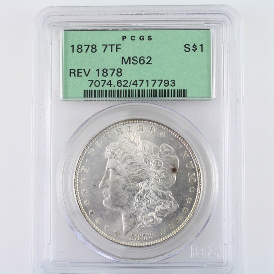 Certified 1878 7 tail feathers, reverse of 1878 U.S. Morgan silver dollar