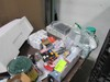Lot On & Under Table, Baby Goods, Crayons, Toys Etc.