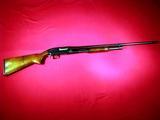 Winchester Model 12 slide action shotgun