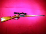 Savage Arms Co. Model 99 lever action rifle in .30-30 cal. with Redfield 1 3/4x5 scope  SN: 306130