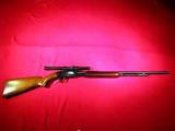 Winchester Model 61 slide action rifle in .22 S., L. & LR cal. with Weaver scope  SN: 23017