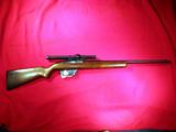 Winchester Model 77 semi-auto rifle in .22. LR cal. with Weaver 2x scope Winchester  SN: N/A