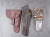 3 leather holsters.
