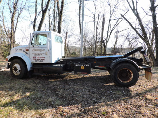 1997 International 4900 Regular Cab - Roll-Off / Hook Truck - with 3 Dumpsters & Flat Bed