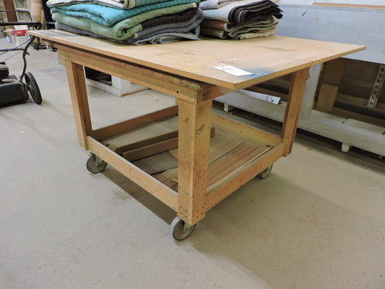 "Rolling Work Table Approx. 5 ft X 4 ft 35"" X Tall"