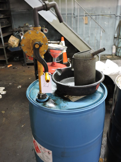 Plastic Drum with Oil Drum Pump / was full of windshield washer fluid