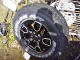 *NOT SOLD*TIRE AND RIM  255-70R-18  JEEP RIM NEVER USE