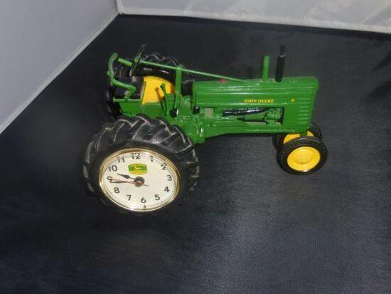 J.D. 1/16 tractor w/clock in wheel
