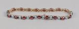 10k Gold Tennis Style Bracelet w/ Red Stones, 7.7 Grams