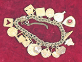 10k Gold Charms on Gold Filled Bracelet, 53 Grams Total Weight
