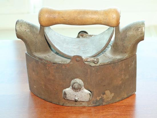 Antique N.E. Plus Coal Burning Cast Iron, Ca. 1902