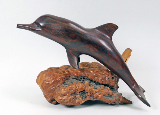 Hand Carved Ironwood Dolphin on a Wood Burl