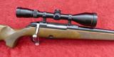 TIKKA Model 695 25-06 Rifle w/Nikon Scope