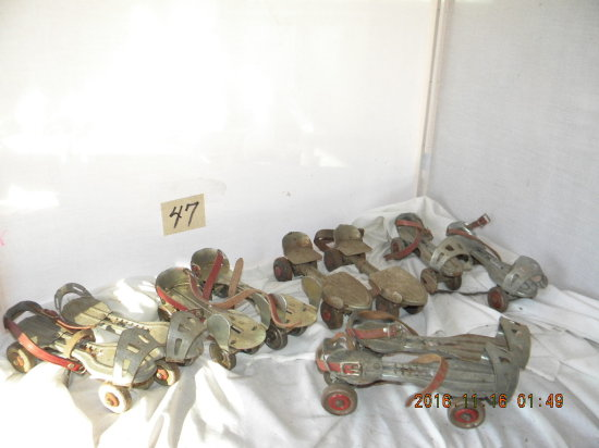 5 Pairs Of Metal Clamp-on Roller Skates.