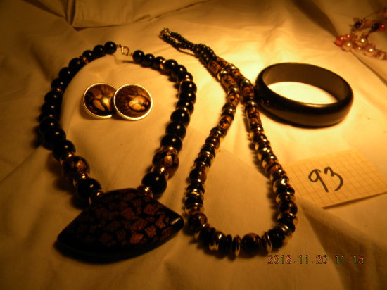 Jewelry = Pair Black/gold Necklaces; Black/gold Pierced Ear Rings; Black B