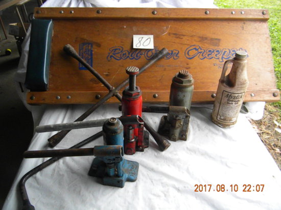 Three Bottle Jacks; Auto Creeper; Tire Irons; And Saw.