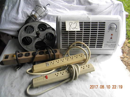 Lot= (3) Power Strips; Trouble Light; Electric Room Heater.