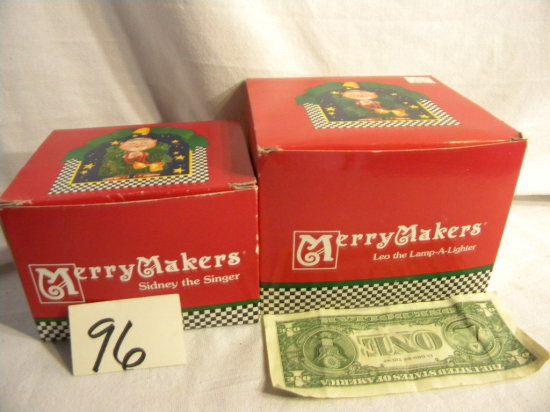 """Department 56 Merrymakers=""""sidney The Singer""""; """"leo The Lamp-a-lighter""""."""