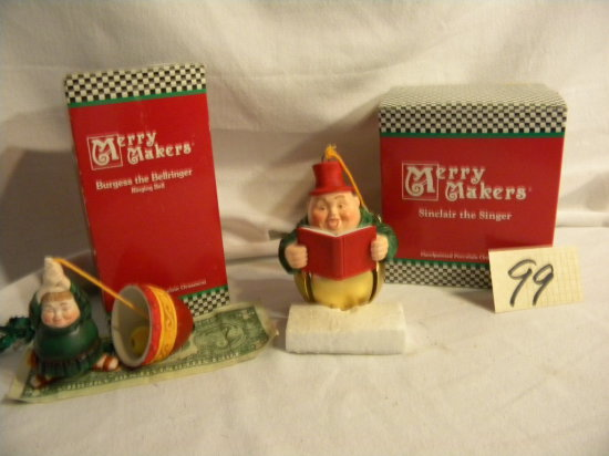 """Department 56 Merrymakers=""""burgess The Bell Ringer""""; """"sinclair The Singer""""."""